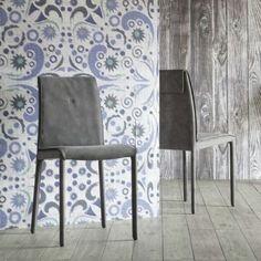 'Amelia' Upholstered chair with double stitching on seat and back. It is available in two different heights.