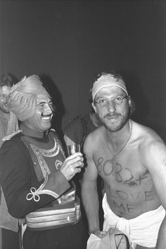 Geoff Boycott and Ian Botham (right) share a joke at the England fancy dress party in Delhi where Botham had come dressed as Boycott. Boycott had just passed the record for most test runs scored. (Adrian Murrell/Allsport UK)