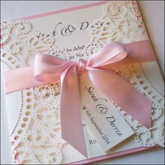 Laser Cut Wedding Invitation with satin ribbon bow.