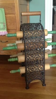 using a wine rack to display old rolling pins I have this rolling pin but with red handles used to have the green but gave it to someone ....