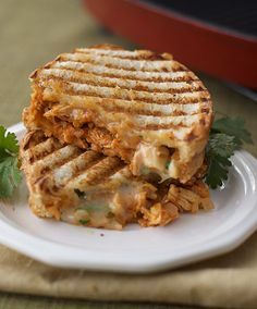 Southwestern chicken panini - shredded chicken in an enchilada sauce cooked panini style with cheese and cilantro. UPDATE:  made these, they were OKAY, not great.  Wouldn't try again