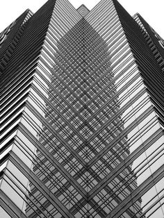 This image captures an abstract pattern that was created on the infrastructure of the building featured. It was taken from a low angle to make the building appear large. The complexity of the design was captured well in this image with all of the edging m Architecture Design, Amazing Architecture, Contemporary Architecture, Contemporary Design, Built Environment, Abstract Photography, Black And White Photography, Geometry, Skyscraper