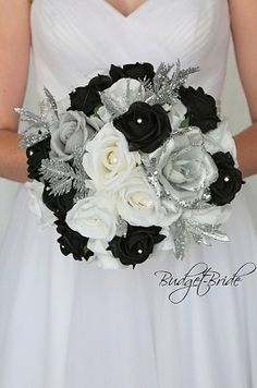Black and Silver Winter Christmas Theme wedding flower brides bouquet with calla lilies roses pearls jewels bling orchids lambs ear seeded eucalyptus fake artificial silk flowers pine cones fir pine christmas greenery berries Black Silver Wedding, Black And White Wedding Theme, Black And White Roses, Gold Wedding, Gothic Wedding, Burgundy Wedding, Spring Wedding, Floral Wedding, Prom Flowers