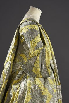 Robe volante, c.1730. Lemon yellow silk lampas woven with a stylized decor of grenades and floral motifs in silver-gilt threads, partially lined with yellow taffeta.   Lyon, France