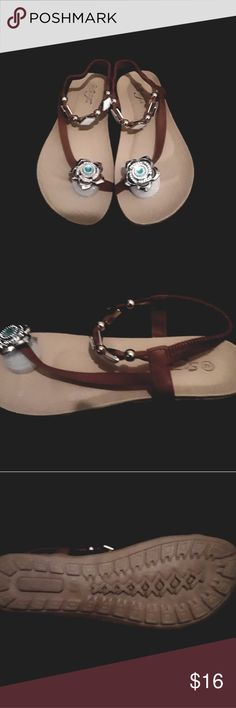 Women's Sandals Brand new ladies sandal. Sizes 6 - 11. These gorgeous sandals are decorated with a jade crystal flower at the toe. Ankle strap is decorated with white diamonds accented with gold. With an added bonus, they are padded for extra comfort. Don't let these get away especially at this price. Shoes Sandals