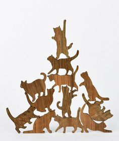 Our feline friends aren't usually known for their teamwork, but in this new reverse Jenga-like game from Comma Design Studio, cats work together to build a careening column of kitties. Laser cut from