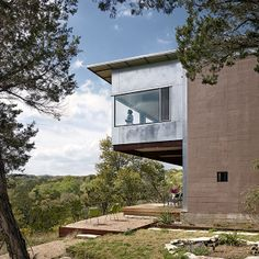 Concrete masonry block, galvalume siding, and cantilevered steel structure overlooking the Texas Hill Country. Live / Work Space by Rick & Cindy Black Architects. Photo by Casey Dunn.