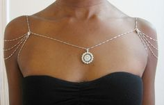 """""""Silver shoulder necklace with round rhinestone pendant.""""   Blue Rose ~ by: Temi ~ This is the most unusual piece that I have seen for a while...draws the eye up and makes the shoulders and the neck appear delicate. Beautiful <3 ~"""