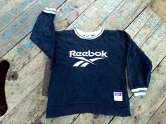 Check out this item in my Etsy shop https://www.etsy.com/uk/listing/466136562/reebok-big-logo-sweatshirt-vintage