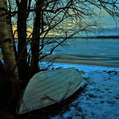 Sleeping Boat on Frozen River Photo by Usman T. Abdul Ghani — National Geographic Your Shot