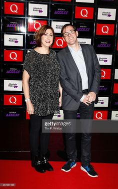 Gillian Gilbert and Stephen Morris of New Order pose for photos in front of the worlds first digital branding board from Sony at the Xperia Access Q Awards at The Grosvenor House Hotel on October 22, 2014 in London, England.