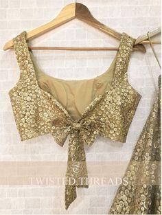 Gold Lehenga Twisted Threads - Price: INR Gold Lehenga Twisted Threads A golden net lehenga with tikki work. Choli Designs, Lehenga Designs, New Saree Blouse Designs, Choli Blouse Design, Blouse Designs Catalogue, Fancy Blouse Designs, Bridal Blouse Designs, Designs For Dresses, Blouse Styles