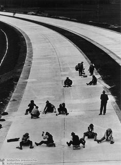 Workers Shortly before the Completion of a New Section of the Reich Autobahn (1936) [Built for fast military transport m.harris]