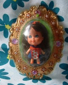 Lucky Locket Kiddles-This is the one I had!  I still have the little doll from mine. She's blonde and has a yellow dress !