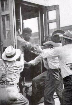 DETROIT RACE RIOT (1943). Black male being pulled off a street car.
