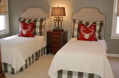 I love: the color, the bow front antique-style nightstand, the simple matelasse coverlet, the use of a modern stripe as an accent, with a pop of color. I also love the functionality of this guest room because the beds could be pushed together for a couple or used as twins.