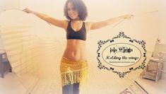 Belly dancing with Isis wings: how to hold the wings ~ Free belly dance classes online with Tiazza Rose