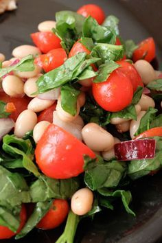 Quick White Bean, Tomato & Spinach Salad... I would make my own salad dressing instead of light Italian