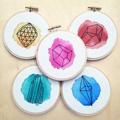 This listing includes a set of 5 (FIVE) watercolor geometric embroidery hoops:  •Yellow •Red •Pink •Green •Blue  The pieces are painted with jewel toned watercolors on 100% cotton light tan muslin fabric. The geometric shapes are then embroidered by me with black embroidery floss inside a 4 wooden embroidery hoop. The fabric is glued securely to the back of the hoop promising a long-lasting piece of art.  NOTE: If you would like a different color, please order from the custom embroidery…