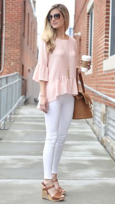 spring outfit ideas: pink ruffle hem top with white skinny jeans and cognac wedges