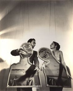 A young Salvador Dalí and Gala with A Couple with Their Heads Full of Clouds, 1936. Photo by Cecil Beaton. Dalí's wife and muse, Gala, whose real name was Elena Ivanovna Diakonova was a mysterious and highly intuitive woman, which was able to recognise artistic and creative genius when she saw it, and had relations with a number of intellectuals and artists.