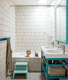 Modern bathroom with irregular tiled wallThe two-bowl sink is the Vitviken model from Ikea; it's topped with a chrome Hansgrohe faucet and accented by Ikea's Godmorgon medicine cabinets customized by the architecture firm MADE. Photo by: Matthew Williams Beautiful Bathrooms, Modern Bathroom, Small Bathroom, White Bathroom, Turquoise Bathroom, Bathroom Storage, Aqua Bathroom, Bathroom Vintage, Minimalist Bathroom
