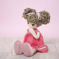PLEASE NOTE THAT THIS LISTING IS FOR THE DOLL ONLY AND NOT THE PROPS SEEN IN THE PHOTO. This is a finished handmade amigurumi crochet doll of a sweet little girl with pigtails in a hand knitted pink dress. This cuddly doll was lovingly handmade with the following materials: - 100%