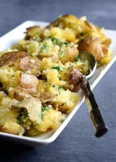 Smashed Potatoes with Parmesan Gremolata are a tasty accompaniment to many meals. Tender boiled potatoes are smashed, baked and topped with parsley and lemon.