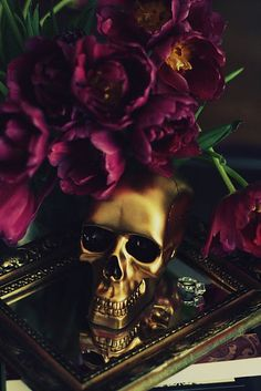 Hauntingly beautiful... gold skull on vanity mirror, the purple flowers are a great addition.