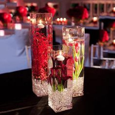 Cheap Wedding Table Centerpiece Ideas - Put the Ring on It Glass Centerpieces, Wedding Table Centerpieces, Wedding Vases, Centerpiece Flowers, Centerpiece Ideas, Flower Arrangements, Floating Candles Wedding, Red Wedding Decorations, Modern Centerpieces