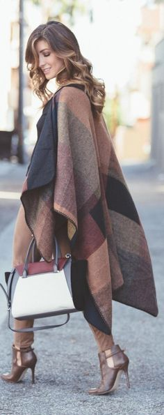 Wear your brown, black and burgundy coloured poncho over matching leggings and shoes. Via Deniz Selin