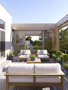 Hamptons New York Residence love the slatted panels for privacy repined by www.claudiadeyongdesigns.com
