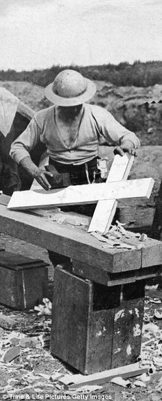 An Allied soldier making crosses to mark graves of those killed in fighting during the First World War
