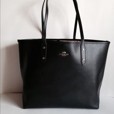 "NWT Coach Crosgrn Blk Lthr Tote ❤️Weekend ❤️SALE NWT Coach crossgrain leather, black,  City Tote. Inside color is nude. Gold hardware.  Hook-type opening and closure.  Inside has one open pocket and one zip pocket. Dual handles have a 10"" drop.  No Trades F35355 Coach Bags Totes"