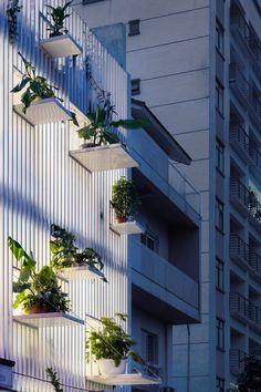 """DANstudio adds """"green balconies"""" to facade of Hanoi townhouse"""