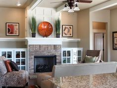 fireplace mantel decorated that is symmetrical and balanced, very simple with a decorative plate and grasses