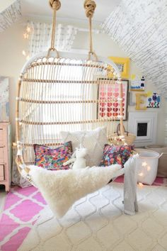 These teenage bedrooms are to do die for, I mean how amazing is this hanging chair for the bedroom? More Inspiring Teen Bedroom Ideas