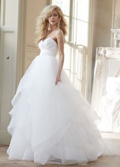 Londyn, Style HP6358  vory strapless natural waist bridal ball gown with silk radzmir crossover bodice, full tulle skirt with horsehair flounces and chapel train. Shown with matching horsehair veil.