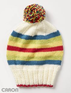 Colorblock striping, and a multi-colored pompom make this hat fun, and bold! Easily knit in Caron Simply Soft. Baby Knitting Patterns, Knitting Designs, Free Knitting, Knitting Projects, Knitting Ideas, Charity Knitting, Loom Knitting, Seed Stitch Hat, Knitted Hats