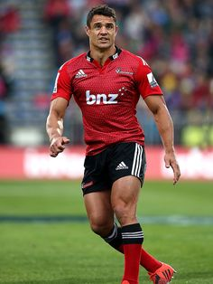 The Crusaders' Dan Carter watches on
