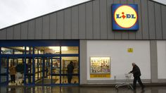 A customer pushes his troll at a Lidl supermarket in Berlin December REUTERS/Fabrizio Bensch Lidl, Berlin, Learn German, Photo Memories, Everything, Cool Photos, Finance, The Past, Germany