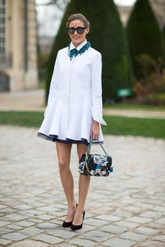 Olivia Palermo combines a simple dress with a statement necklace and bag.
