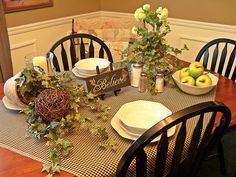 A simple place setting can be so welcoming. (What a cute idea to place a pot of ivy on its side, having the vines trail across the table.)