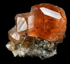 This is a SPESSARTITE GARNET also known as a mandarin garnet. Brightly colored stone large deposits are mined in Sri Lanka, India and Israel. Minerals And Gemstones, Crystals Minerals, Rocks And Minerals, Stones And Crystals, Garnet Gem, Garnet Stone, Birthstone Gems, Gems Jewelry, Emerald City