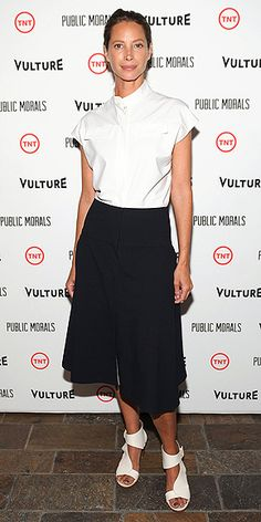 Last Night's Look: Love It or Leave It? Vote Now! | CHRISTY TURLINGTON BURNS | in a mock-turtleneck shirt, black A-line skirt and white ankle strap sandals at the premiere of Public Morals in N.Y.C.
