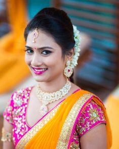 South Indian bride. Diamond Indian bridal jewelry.Temple jewelry. Jhumkis. Orange silk kanchipuram sari with contrast pink blouse.braid with fresh jasmine flowers. Tamil bride. Telugu bride. Kannada bride. Hindu bride. Malayalee bride.Kerala bride.South Indian wedding.