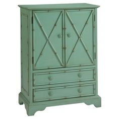 Washed in a seafoam green finish, this colorful cabinet is at home in breezy tropical retreats and Lowcountry cottages alike. Let it stow board games and boo...