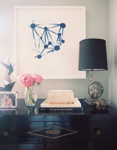 console styling Graphic art + antiques | Lonny Magazine Jul/Aug 2011 | Photography by Patrick Cline; Interior Design by Lauren Gold