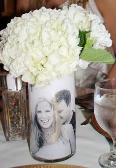 Create your own beautiful photo centerpieces with this easy tutorial. Great idea for weddings, showers, rehearsal dinners, anniversaries & birthday parties