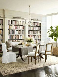 TOUR: A Fashion Designer's Tailored Texas Penthouse Bookcases line a wall in a Texas penthouse's elegant dining room.Bookcases line a wall in a Texas penthouse's elegant dining room. Interior Design, House Interior, Dining Room Combo, Living Dining Room, Dining, Room, Interior, Home Decor, Dining Room Decor